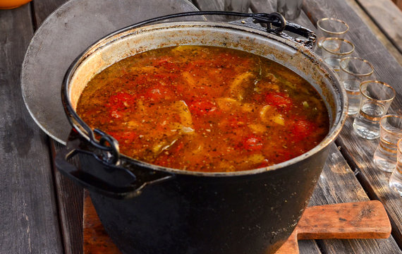 Close-up of hot beef hunting goulash or bograch soup with paprika, small egg pasta