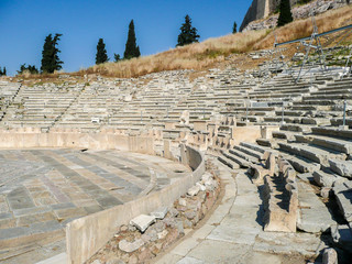 The Theatre of Dionysus Eleuthereus of the Athenian Acropolis. Athens, Greece. Ancient greek amphitheater. old ruins, spectators' or VIPs seats at the first rows