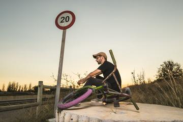 Young with bmx bike rider.Urban street sport concept