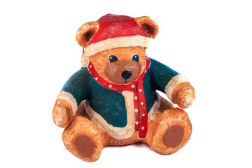 bear dressed for christmas on a white background