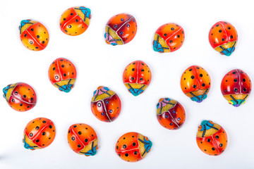 beautiful set of multicolored ladybugs in Mexican ceramics, top view, copy space, flat lay