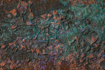 fascinating abstraction texture of rusty metal close up the surface of which is covered with bright colorful paint