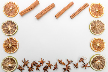 autumn composition with slices of dried oranges, anise flower and cinnamon on a white background, autumn concept, flat lay, top view