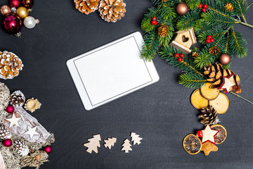 Flatlay of christmas concept with white tablet and blank space with black background