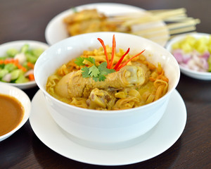 Egg noodle in chicken curry soup (Kao Soi Kai ), Thai Northern style food.