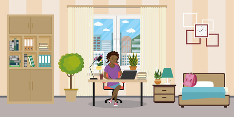 Teen room interior.African american female teen working on laptop