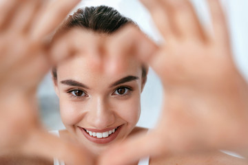 Eye Health. Beautiful Woman Face With Heart Shaped Hands. Beauty
