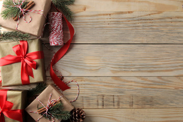 New Year. Christmas. Holidays. Composition with new year and christmas gifts on brown wooden background. view from above