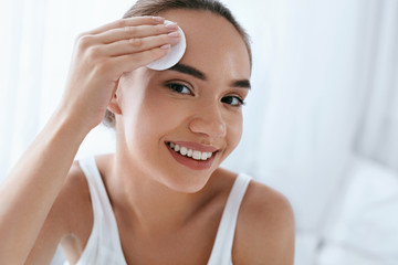 Clean Face. Beautiful Woman Cleaning Skin With Cosmetic Pad