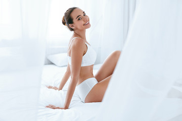 Happy Woman With Beautiful Face And Body. Beauty And Skin Care