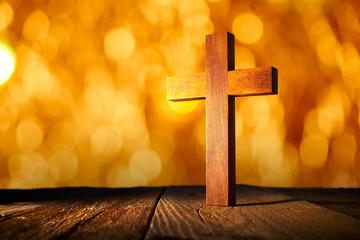 Christian wood cross on blur flare lights