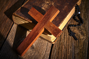 Christian cross on wood bible and rosary