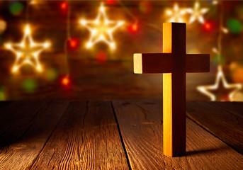 Christian wood cross on Christmas stars