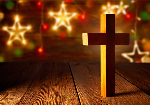 Christian wood cross on Christmas stars
