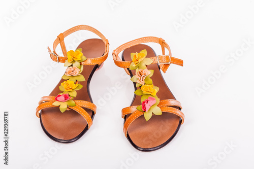 67bbf2d79a076 Female shoes isolated on the white background. Female sandals with a leather  decorations in the shape of flowers.