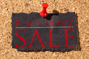 Cork panel. Red thumbtack, black paper: Black Friday concept. Text: Black Friday Sale
