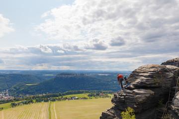 rock climber at mountain lilienstein, saxon switzerland, germany