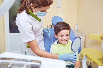 A child with a dentist in a dental office. Dental treatment in a children's clinic.