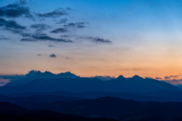Scenic view of beautiful High Tatras mountains. Blue hour sunset with pink and blue tones, Slovakia.
