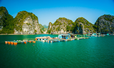 Floating village of fishers and fish or oyster farmers in Halong Bay, Vietnam