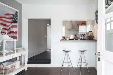 White modern kitchen with sidewalks and united states flag