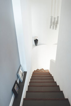 A flight of stairs in modern white house