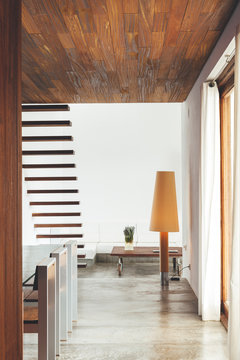 Modern living room with wooden decoration and polished concrete