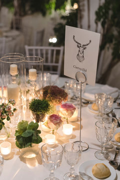 Decorated table for a wedding at night with candles