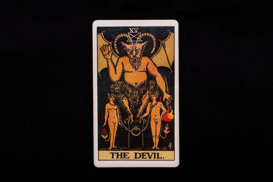 An individual major arcana tarot card isolated on black background. The Devil.
