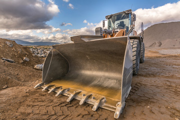 Quarry aggregate with heavy duty machinery. Construction industry.