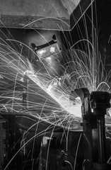 worker with protective mask welding metal, Black&White