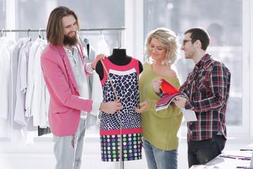 designers discussing new fabric colors in creative Studio