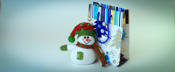snowman and shopping bag.isolated on white background