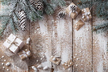 Christmas gifts on old wooden background