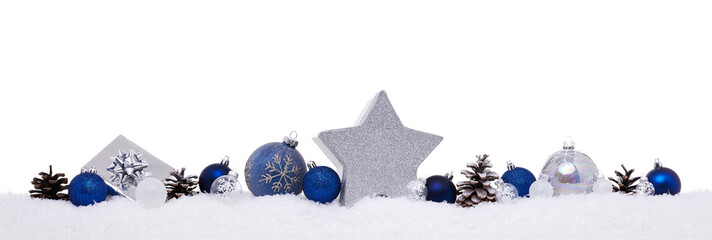 Blue and silver christmas balls with xmas present gift boxes isolated on snow