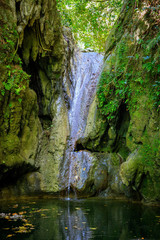 Secret waterfall in the middle of the jungle and mountains of Puerto Plata, Dominican Republic.