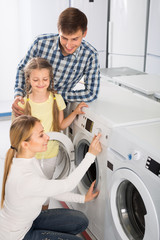 Positive family in store with electronics