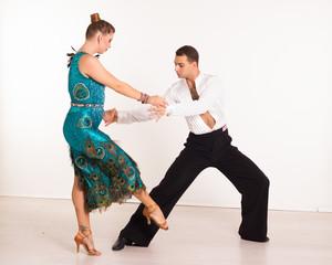 Dancing beautiful couple, indoor