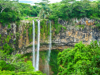 Ingelijste posters Watervallen The Chamarel falls, 100 meters high, the most famous waterfalls in Mauritius at a short distance from the colored earth, Mauritius, Indian Ocean.