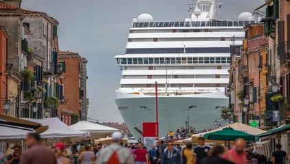 Italy beauty, like a horror movie scene, gigantic cruise ship leaving Venice, Venezia