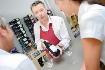 Wine specialist recommending a bottle