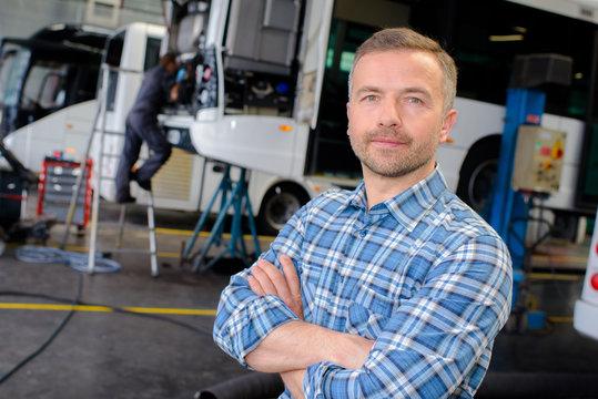 garage manager posing