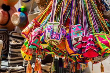 Zelfklevend Fotobehang Zuid-Amerika land Street sell of handcrafted traditional Wayuu bags in Cartagena de Indias