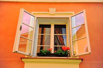 Beautiful open window in orange stone house