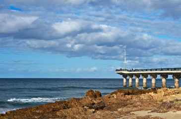 A landscape image of the Shark Rock Pier in Port Elizabeth, South Africa. This is a popular tourist attraction in the city.