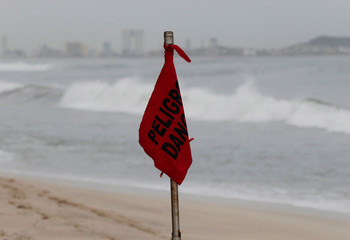 A red flag, warning of dangerous conditions, is seen at a closed beach in Mazatlan as Hurricane Willa approaches the Pacific beach resort