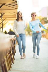 Two young women walking