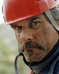 Portrait of a mature construction worker wearing a hard hat.