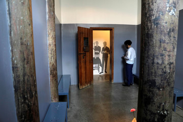 A person is seen inside a cell at the Memorial of the Resistance of Sao Paulo, a former political prison in Sao Paulo