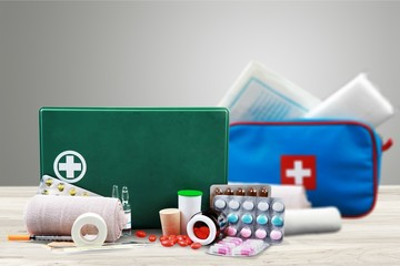 First aid kit with medical supplies on